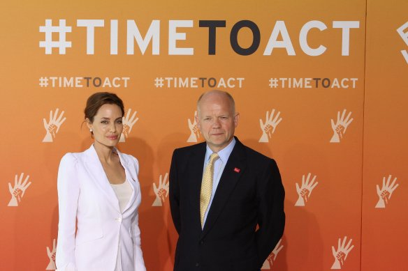 Angelina Jolie and Foreign Secretary William Hague at the Global Summit to End Sexual Violence in Conflict. CC BY 2.0 Foreign and Commonwealth Office
