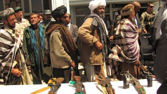 Former Taliban fighters line up to handover their Rifles to the Government of the Islamic Republic of Afghanistan during a reintegration ceremony at the provincial governor's compound. Wikimedia Commons