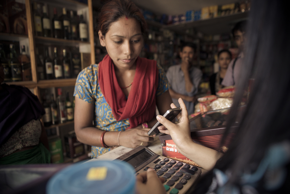 Testing a new system of emergency assistance in Nepal. Recipients receive virtual vouchers via SMS message on mobile phones that can be used like cash at participating local stores. Photo: Suraj Shakya for Mercy Corps.