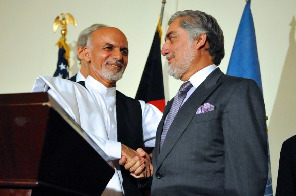 Afghan presidential candidate Ashraf Ghani shakes hands with rival candidate Abdullah Abdullah after both addressed reporters at the United Nations Mission Headquarters in Kabul, Afghanistan on July 12, 2014, about the details of an agreement on a technical and political plan U.S. Secretary of State John Kerry helped broker to resolve the disputed outcome of the election between him and Abdullah.