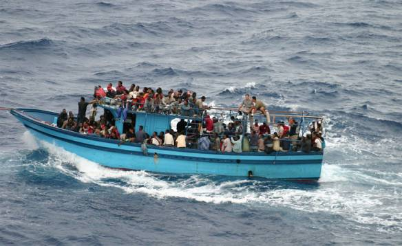 A boat carrying asylum seekers and migrants in the Mediterranean Sea. Photo: NHCR/L.Boldrini