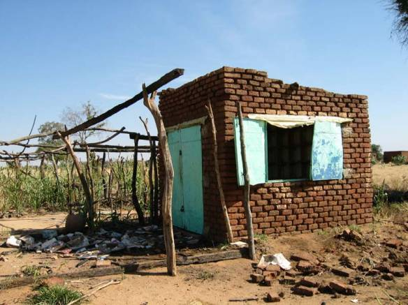 A village health post destroyed by Jingaweit militia.  By United States Agency for International Development [Public domain], via Wikimedia Commons