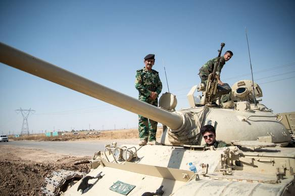 Kurdish Peshmerga on a T-55-Tank outside Kirkuk in Iraq. Photo: Boris Niehaus. CC BY-SA 3.0