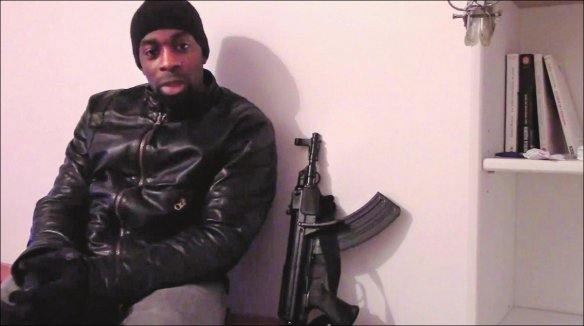 One of the killers, Amedy Coulibaly, posed next to a firearm in a video; and it has been identified as a Czech made Czech VZ-58 carbine. If that's correct and it was fully automatic then he couldn't have purchased it legally in France. Screenshot from video.
