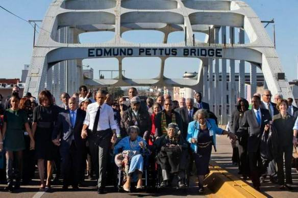 Celebration at the Edmund Pettus bridge, Selma, 7 March 2015. John Lewis between Michelle and Barack Obama. Photo: The Kansas City Star