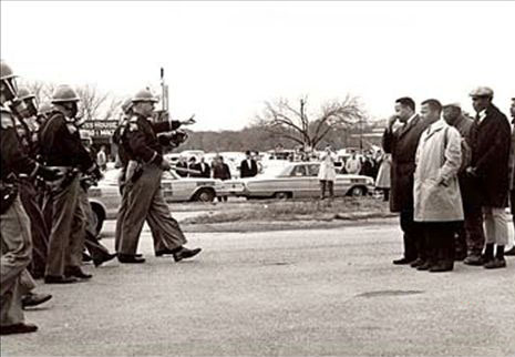 Confrontation at the Edmund Pettus Bridge, Selma, 7 March 1965. John Lewis on the right in a white coat.