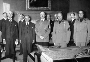 From left to right, Chamberlain, Daladier, Hitler, Mussolini and Italian Foreign Minister Count Ciano as they prepare to sign the Munich Agreement. Photo: Bundesarchiv