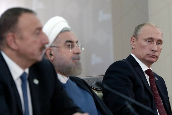 Putin tries to make a clever face, and Rouhani doesn't have to.