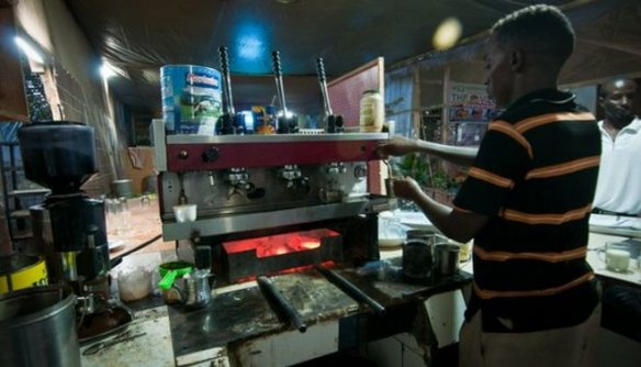 Living in a recovering failed state like Somalia means being innovative. At The Village Restaurant, a popular open-air hangout for Mogadishu's returning diaspora community, a charcoal-powered Italian espresso machine brews Somalia's best cappuccino. Photo: BBC