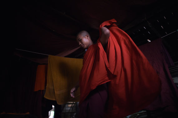 A Buddhist monk adjusts his robe at a monastery affiliated with the Ma Ba Tha (Organization for the Protection of Race and Religion) on the outskirts of Yangon. The Ma Ba Tha organization, mainly active in Yangon and the northern city of Mandalay, promotes hardline Buddhist nationalism in Myanmar.