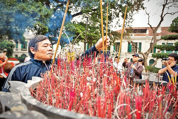 Vietnamese protesters burn incense to pray on the anniversary of  64 Vietnamese soldiers who died on 14 March 1988 during an attack by Chinese soldiers on Gac Ma island, one of the disputed Spratly Islands, in Hanoi, Vietnam, 14 March 2013. The protesters also shout slogans asking for an end of Chinese aggression in the South China Sea, parts of which are claimed by both Vietnam and China.  EPA/LUONG THAI LINH