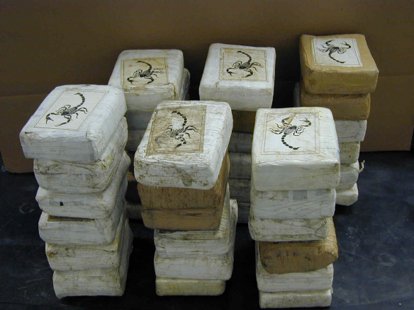 Bricks of cocaine, a form in which it is commonly transported. Wikimedia Commons.