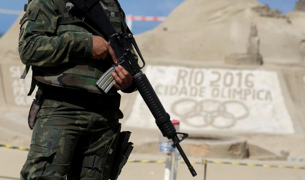 A Brazilian Army Forces soldier patrols on Copacabana beach ahead of the 2016 Rio Olympic games in Rio de Janeiro, Brazil. REUTERS/Ricardo Moraes