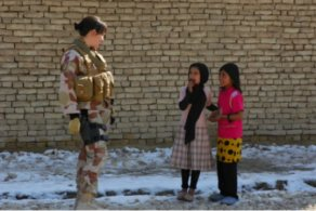 One of the military gender advisers talking to local kids in Faryab. Photo: Geir Bøe/Norwegian Defence