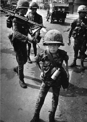 Child soldiers are not a new phenomenon - Ten year old South Vietnamese soldier. Photo: Philip Jones Griffith